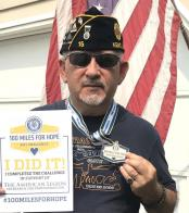 U.S. Army retiree, post second vice commander receives 100 Miles for Hope completion certificate/medal