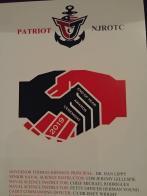 Francis Scott Key Post 11 Commander Keith Clevenger presents Navy JROTC medals to cadets