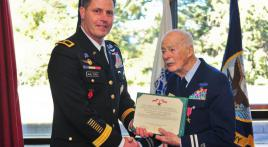Colonel uses his retirement ceremony to honor World War II veteran