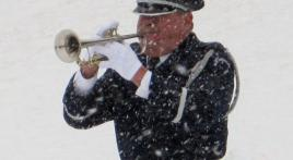 Military bugler performs at 10,000th service