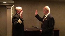 Father gives Oath of Office to son