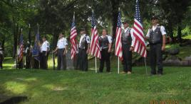 Winona Riders stand flag line for grave rededication