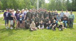 Youth help vets with cemetery flags