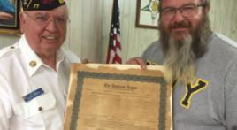 Original charter is returned to Bentonvile, Ark., Post 77