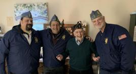 Squadron 440 presents garrison cap to Korean War veteran