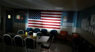 The flag in a darkened room