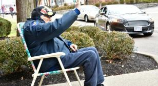 Drive-by birthday parade for 101-year-old World War II veteran
