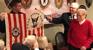 WWII Coast Guard veteran presents USS Machias flag to Grand Haven U.S. Coast Guard Station