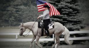 Granddaughter carries American flag